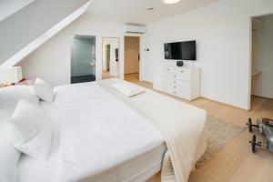 Ein Bett oder Betten in einem Zimmer der Unterkunft Galerie 18 Apartments