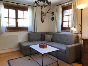 Ein Sitzbereich in der Unterkunft Bachhäusl