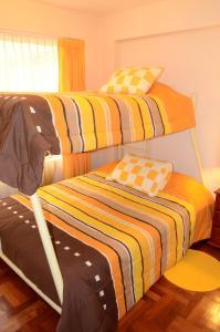 Cama o camas de una habitación en Sarat´ika Apartamento Cusco