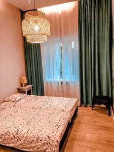 A bed or beds in a room at Rent-Apart City Center Lodz
