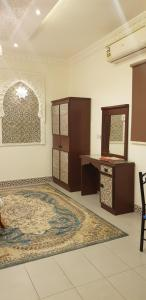 A bed or beds in a room at Nozol Al Toot Furnished Units