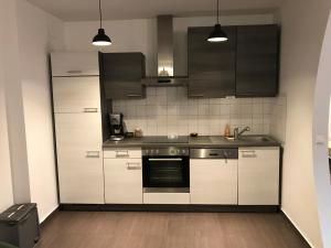 Küche/Küchenzeile in der Unterkunft Helle-, geräumige Wohnung in zentraler Lage