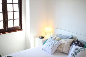 A bed or beds in a room at Vila Mafra - Grill Terrace