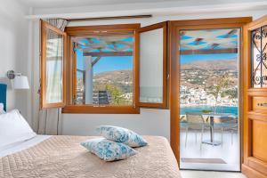מיטה או מיטות בחדר ב-Belvedere Andros