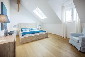 Ein Bett oder Betten in einem Zimmer der Unterkunft Exclusive Penthouse Idomeneo