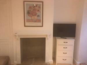 A television and/or entertainment center at One Bedroom Groundfloor Apartment