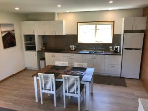 A kitchen or kitchenette at Loma Cottages