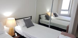 A bed or beds in a room at Moroccan View Tower Surfers Beach