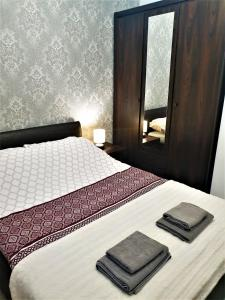 A bed or beds in a room at Lux Apartment Park
