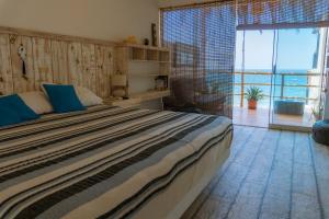 Cama o camas de una habitación en Punta Sol Apart Hotel