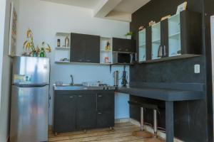 Una cocina o zona de cocina en Punta Sol Apart Hotel