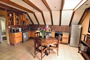 A kitchen or kitchenette at Emzini Apartments