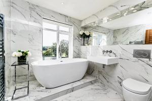 A bathroom at The Racecourse Apartments- Luxury and location