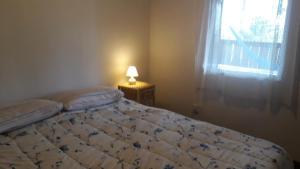 Cama ou camas em um quarto em Chalés Picharro