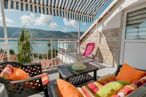 A balcony or terrace at Apartments and Rooms Bumerang