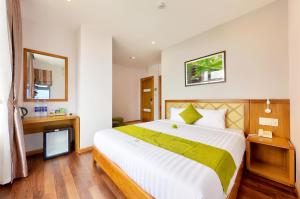 A bed or beds in a room at Richico Apartments And Hotel