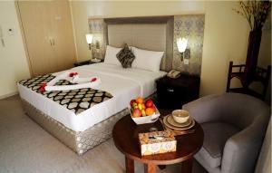Uma cama ou camas num quarto em Parkside Hotel Apartment
