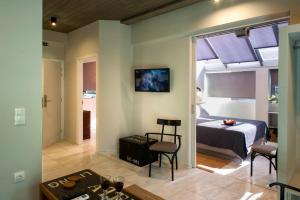 A television and/or entertainment centre at Caravel Voyage Suites by Living-Space
