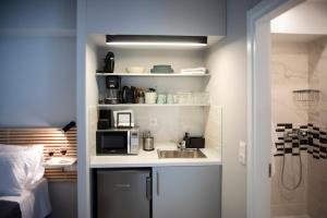 A kitchen or kitchenette at Caravel Voyage Suites by Living-Space