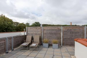 Een balkon of terras bij Duinhof Dishoek Luxe appartementen