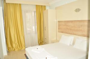 Кровать или кровати в номере Kemer Suites