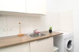 A kitchen or kitchenette at Prime Apartments 44