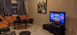 A television and/or entertainment center at For a Stopover or a quiet Break