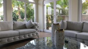 A seating area at The Paradise on the Palm Villa
