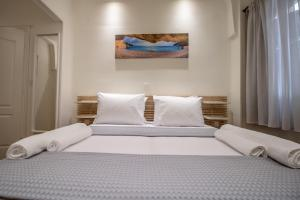 A bed or beds in a room at Levkosh Apartments at Lefkada's Heart