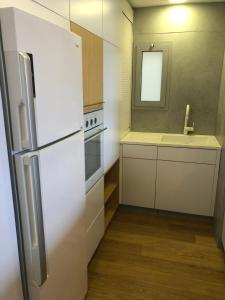 A kitchen or kitchenette at W Apartments