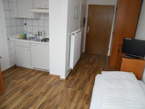 A kitchen or kitchenette at Apartments Duval