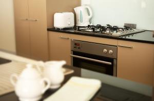 A kitchen or kitchenette at Park Avenue – Glenview Glen Waverley