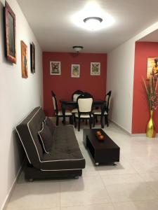 Uma área de estar em Apartmentos Tropical Dreams 2