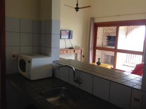 A kitchen or kitchenette at Praia Brava Apto 2 dorms Vista ao Mar