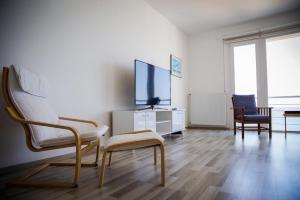 A television and/or entertainment centre at Luxury Seahouse