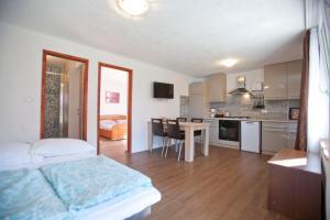 A kitchen or kitchenette at Apartments Šeherzada