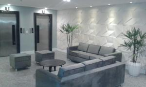 The lobby or reception area at Flat Atlântico Mobiliados