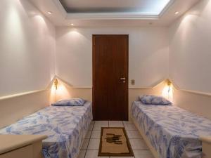 A bed or beds in a room at Apto no open shopping Jurerê Internacional CDS208