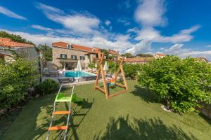 Children's play area at Villa Joe with heated pool