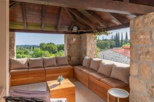 A seating area at Villa Joe with heated pool