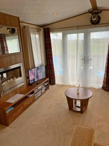 A television and/or entertainment center at 22 Aimie Lodge