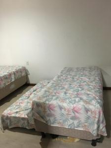 Cama o camas de una habitación en Casa com Piscina temporada