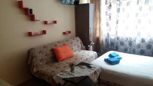 Ένα ή περισσότερα κρεβάτια σε δωμάτιο στο Ano Ladadika