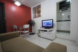 TV a/nebo společenská místnost v ubytování Apartamento Forte Copacabana