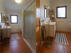 A bathroom at Sintra Beach Retreat by be@home