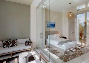 A bed or beds in a room at The Residences at Seafire