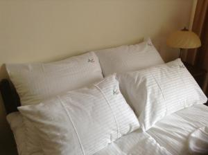 A bed or beds in a room at Ac Apartament Czestochowa