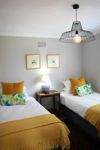 Olive tree private apartments in Stellenboschにあるベッド