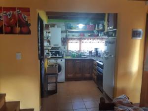 A kitchen or kitchenette at Marferrom Cabin