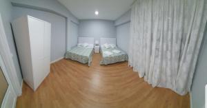 Posteľ alebo postele v izbe v ubytovaní el principe